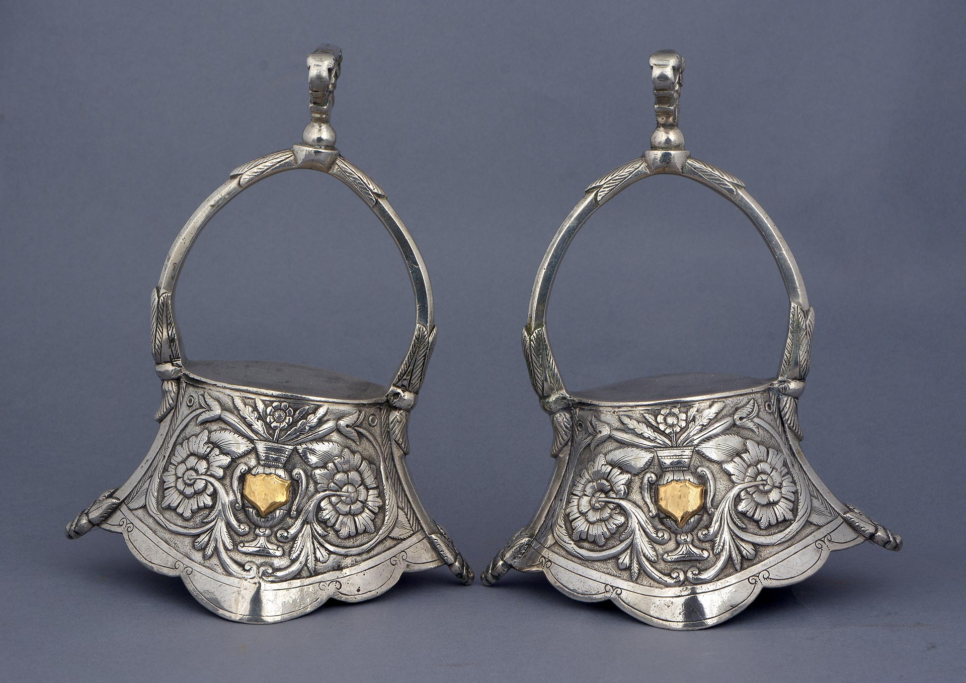 PAIR OF PARCEL-GILT SILVER AND GOLD BELL STIRRUPS