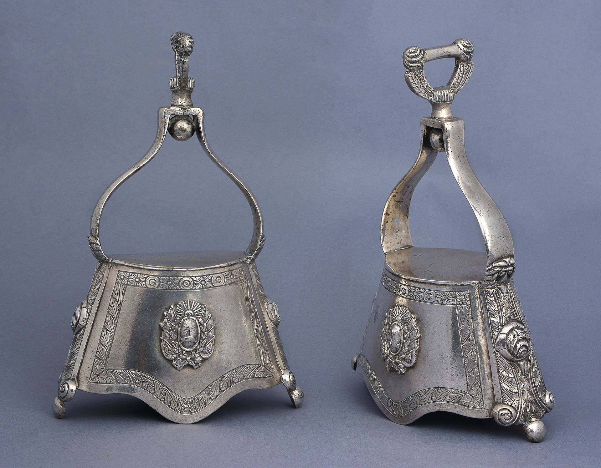 A PAIR OF SILVER BELL STIRRUPS